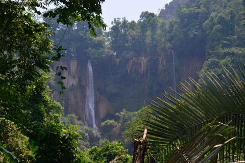 A first glimpse from afar. Photo taken in or around Thi Lor Su Waterfall, Umphang, Thailand by David Luekens.