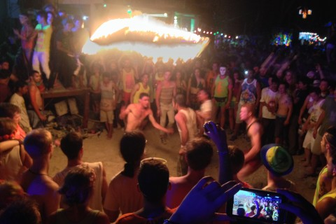 Thrill Mum & Dad by doing the fire rope. Photo taken in or around Thailand's Full Moon Party, Ko Pha Ngan, Thailand by Stuart McDonald.