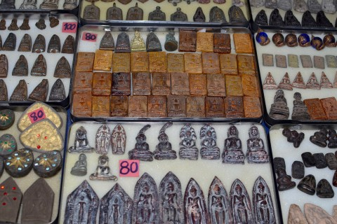 Treat your amulet well—or it might put a curse on you. Photo taken in or around Phra Chan amulet market, Bangkok, Thailand by David Luekens.