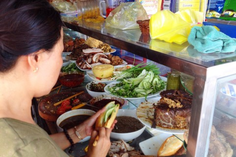 Grabbing a banh mi on the run. Photo taken in or around Food tours, Hoi An, Vietnam by Cindy Fan.