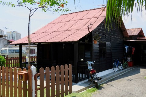 One of the old wooden houses remaining today. Photo taken in or around Kampung Portugis (Portuguese Settlement), Melaka, Malaysia by Sally Arnold.