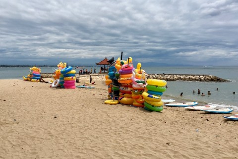 Dark skies bright tubes. Photo taken in or around Sanur Beach, Sanur, Indonesia by Sally Arnold.